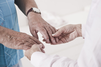 Close-up of Caregiver holding Patient's Hands
