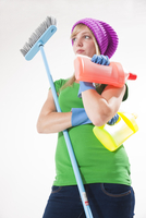 Portrait of Young Woman with Cleaning Supplies