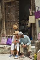Basket Seller with Tourist, Stone Town, Unguja, Zanzibar, Tanzania