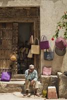 Basket Seller Using Cell Phone, Stone Town, Unguja, Zanzibar, Tanzania