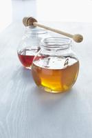 Jars of Honey with Honey Dipper