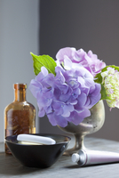 Bathing Products and Hydrangeas on Table