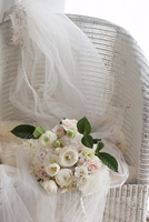 Bridal Bouquet and Veil on Chair