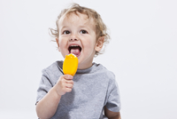 Portrait of Boy Eating Ice Cream Treat