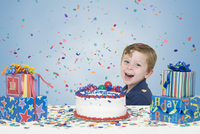 Young Boy with Birthday Cake and Presents
