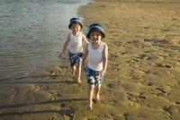 Twin boys Walking on Beach