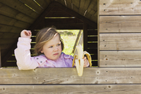 Young Girl Eating Banana while Looking out of Barn Window, Sweden 11030051078| 写真素材・ストックフォト・画像・イラスト素材|アマナイメージズ