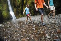 People Hiking in Oneonta Gorge, Oregon, USA