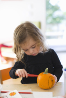 Girl Carving Pumpkin, Portland, Multnomah County, Oregon, USA