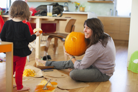 Girl and Mother Carving Pumpkin, Portland, Multnomah County, Oregon, USA
