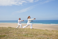 Couple Practicing Yoga on Beach, Camaret-sur-Mer, Finistere, Bretagne, France