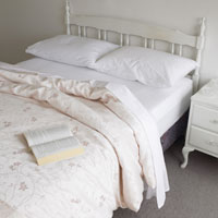 Open book on double bed