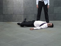 man standing over colleague lying