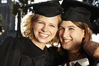 Women in graduation gowns smiling