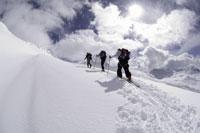 Three men backcountry skiing