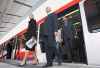 Business Commuters Getting off a Train  motion blur  low a