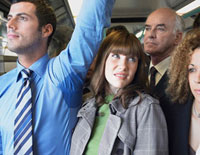 Female Commuter Standing by Mans Wet Armpit on Train
