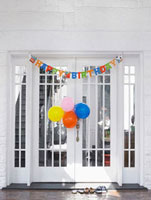 Brthday decorations at front door of house