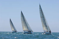 Three yachts compete in team sailing event