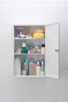 Various cosmetics and bath products in bathroom cabinet