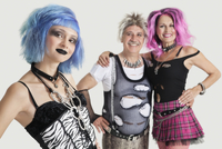 Group portrait of young female punk with senior couple stand
