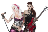 Portrait of punk rock musicians with electric guitar and mic