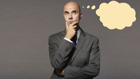 Bald businessman thinking with speech bubble over gray backg
