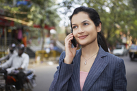 India business woman using mobile phone on street