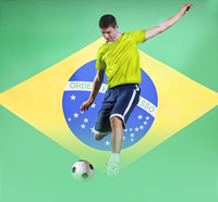 Football player shooting in front of Brazil National Flag