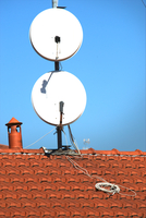 Satellite dishes on a tiled roof