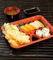 Shrimp tempura and sushi in bento box