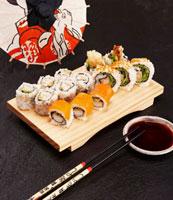 Assorted sushi rolls on sushi board