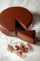 Sachertorte (Austrian chocolate cake) with a piece cut