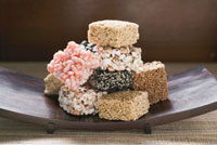 Asian sweets on wooden plate