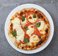 Tomato and mozzarella pizza with basil