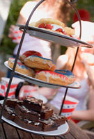 Brownies,doughnuts & strawberry shortcake on tiered stand