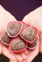 Woman holding heart-shaped chocolate buns
