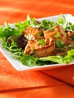 Salmon fillet with coriander on a mixed leaf salad