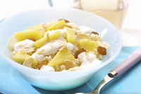 Sweet couscous with pineapple, raisins and sliced almonds