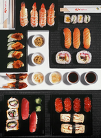 Different types of sushi with ginger, wasabi and soy sauce (view from above)