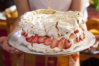 Pavlova with creamy lemon filling and strawberries