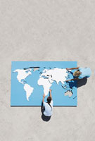 Aerial View of two people doing world map puzzle outdoors