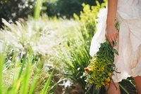 Woman carrying flowers in garden