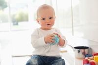 Baby holding toy globe