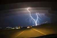Lightening on nightly sky seen from car