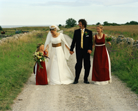 Scandinavia, Sweden, Oland, Bride and groom with bridesmaid