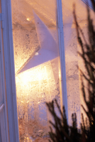 Close up of frozen window with Christmas decorations