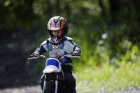 Boy riding motorcross cycle