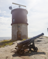 Lighthouse with old cannon on foreground