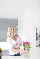 Woman holding newborn daughter